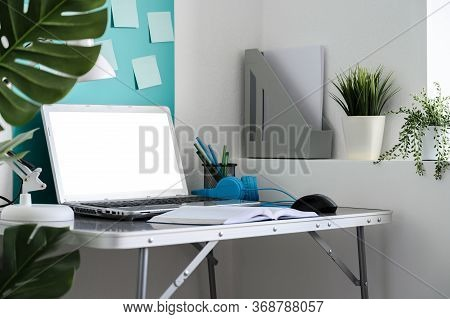 Home Office Workplace With Laptop. Modern Creative Workspace At Home. Horizontal Orientation.
