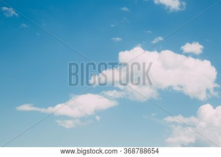 White Beautiful Fluffy Clouds On A Blue Clear Sky, Place For Text