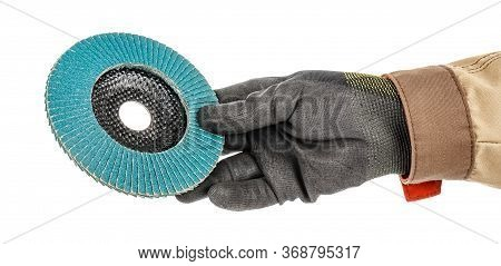 Unused Abrasive Flap Disc For Grinding In Worker Hand In Black Protective Glove And Brown Uniform Is