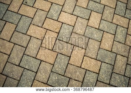 Cubical Stone Background. Cubical Stone Pavement On The Street.
