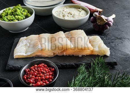 Organic Fish And Chips Ingredients Raw Cod Fillets On Stone Slate Batter, Potatoe, Tartar Sauce, Min