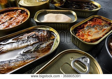 Conserves Of Canned Fish With Different Types Of Fish And Seafood, Opened And Closed Cans With Saury