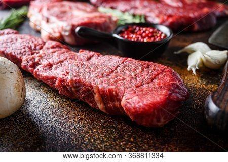 Side View Close Up Denver Steak, Flank Steak, Cut Near Denver Alternative Beef Steak And A Cleaver B