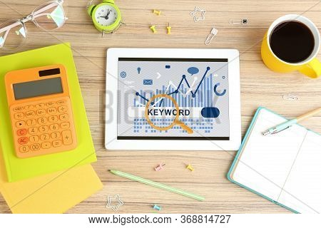 Keywords Research Concept. Modern Tablet With Search Bar On Wooden Table, Flat Lay