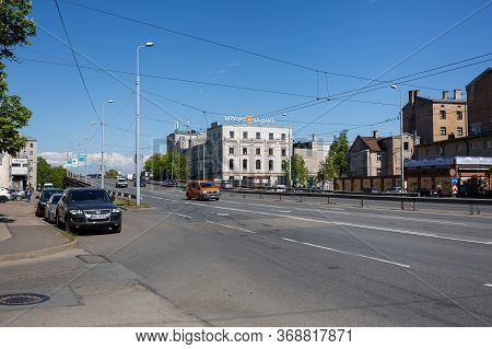 City Riga, Latvia.latvian Balsam Factory And Old Bridge With Cars And Buildings.29.05.2020