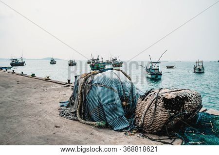 Abandoned Fishing Gear At A Pier. Traditional Local Craftsmanship In Sri Lanka. Cold Colors And Grey