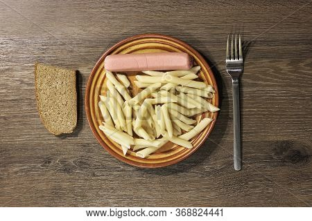 Pasta And Sausage In A Plate. Fast And Cheap Breakfast. Homemade Food. Fast Food. Quarantined Meals