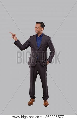 Businessman Poiting To Side Isolated. Indian Man Standing Full Lenght