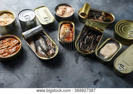 Assortment Of Cans Of Canned With Different Types Of Fish And Seafood, Opened And Closed Cans With S
