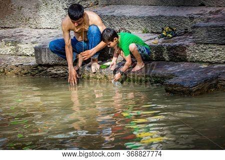 Kathmandu,nepal - August 14,2019: Hindu Brahmins Praying With God In Holy River During Janai Purnima