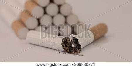 A Half-cigarette Close-up The Central Area Of The Cigarette And The Inside Of The Tobacco Pipe Has B