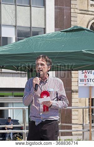 Weston-super-mare, Uk - July 6, 2019: Councillor Tim Taylor Speaks At A Demonstration Against The Ov