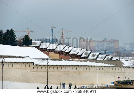View Of The Wall Of The Kazan Kremlin And The Construction Of A New Residential Neighborhood