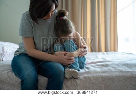 Loving Young Mother Touching Upset Little Daughter, Expressing Support, Young Mum Comforting Offende