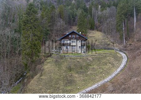 House Built In A Traditional Tyrolean Style On A Mountainside. Innsbruck, Austria, Beginning Of Marc