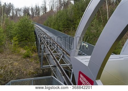 Cable Car Roadway In The Forest On A Mountainside. Innsbruck, Austria.