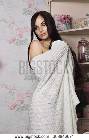 A Girl Stands Wrapped In A Blanket. A Gentle Image Of A Girl. The Blanket Accentuates The Figure. Re