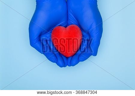 Heart In Hands Stock Photo.health Insurance Or Love Concept.cardiology And Heart Disease Concept.han