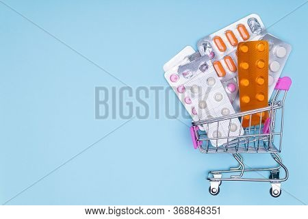 Drug Treatment Concept.take Medication Prescribed By The Doctor.consumers Basket On Blue Medical Bac