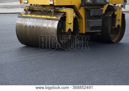 Repair Of Roads. Laying Asphalt With A Roller.