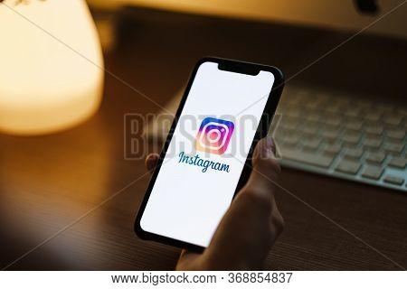 Woman Use Instagram App, Instagram Logo On The Screen.