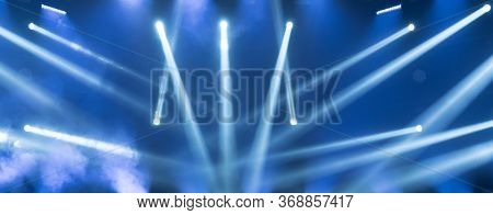 Show Must Go On. Empty Stage With Blue Spotlights. Blue Stage Lights. Concert Live Streams Available