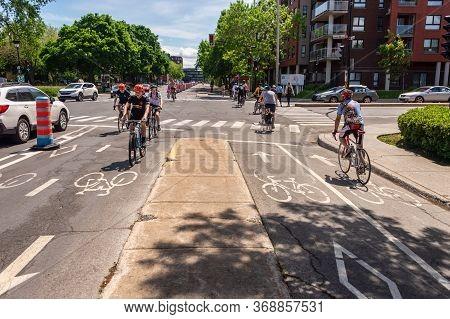 Montreal, Ca - 30 May 2020: Cycling Corridor On Rachel Street In The Rosemont - La Petite-patrie Bor