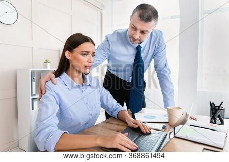 Sexual Harassment Concept. Lustful Businessman Touching Womans Shoulder Sexually Harassing Female Wo