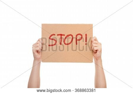 Demonstrator Hands Are Holding Protest Poster With The Message Stop, Cardboard With Text Mockup Isol
