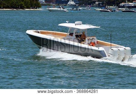 Upscale Motor Boat Speeding Past Monument Island On The Florida Intra-coastal Waterway Near Miami Be