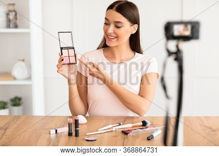 Beauty Blogger Making Makeup Video Tutorial Sitting In Front Of A Camera At Home. Blogging And Onlin