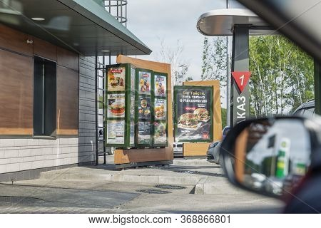 Moscow, Russia, 26/04/2020: Line-up Of Cars And Mcdonald's Take-away. Drive Thru.
