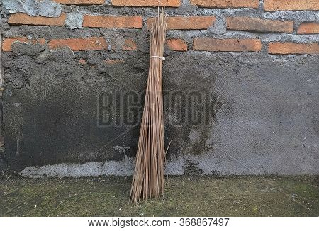 Traditional Broom Sticks In The Yard, Isolated Broom Sticks