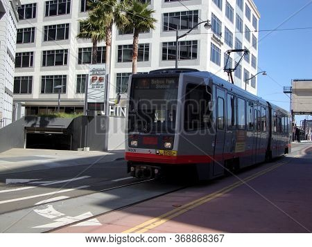 San Francisco - April 6, 2010: T Muni Light-rail Train With Ad On Side On 4th Street In Mission Bay.