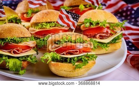 Good Appetizer Ciabatta Roll Sandwiches On White Background With Flag. Independence Day Food Deliver