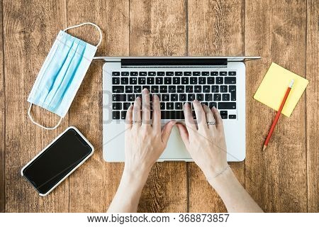 Working From Home On A Computer During Covid Pandemic. Female Person Using Laptop In The Home Office