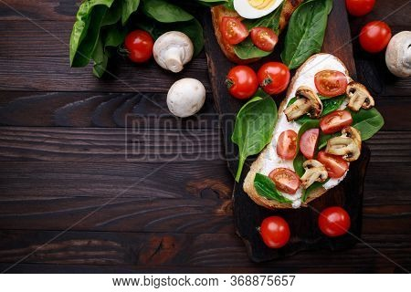 Bruschetta With Tomatoes, Ricotta And Basil On A Cutting Board. Homemade Italian Appetizer, Healthy