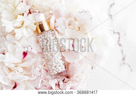Luxurious Cosmetic Bottle As Antiaging Skincare Product On Background Of Flowers, Blank Label Packag