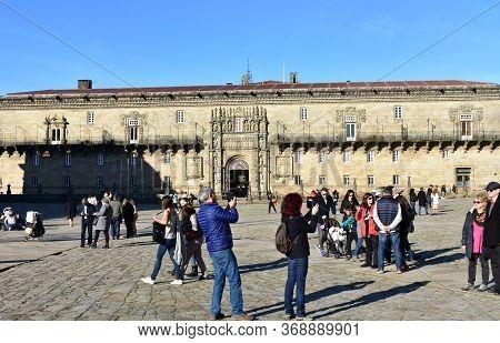 Santiago De Compostela, Spain. December 29, 2019. Tourists Taking Pictures At Praza Do Obradoiro, Fi