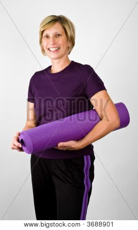 Physically Fit Senior Women With Polaties Mat