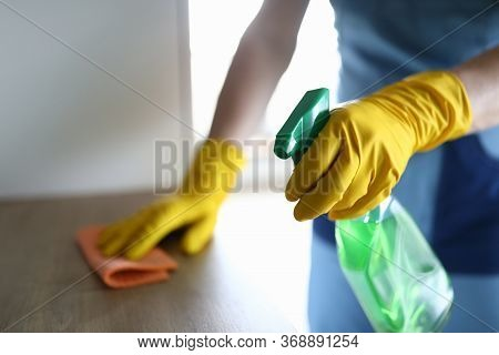 Female Hands In Gloves Disinfect Table At Home. Thorough Cleaning Workplace. Hand Glove Wipes Surfac