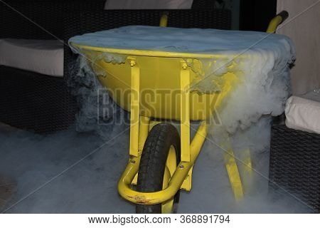 Christmas, X-mas, Birthday, Winter And People Concept, Closeup Yellow Trolley  With White Fog At Dar