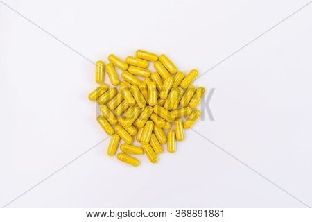 Yellow Capsules On A White Background, Pills For Health, Antibiotics Against Parasites, Yellow Powde