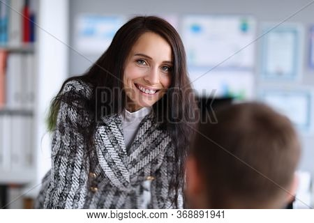 Woman Stands Near A Man In Office And Smiles. Professional Choice Dress Code For Workplace. Professi