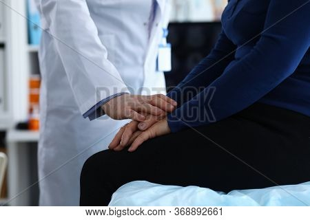 Woman Sitting On Clinic, Doctor Reassuring Patient. Doctor Helps Elderly Woman To Resist During Illn