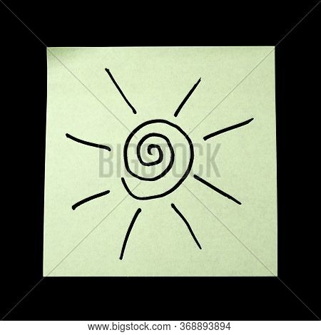 Paper Sticker With The Image Of The Symbol Of The Sun On Dark Background.