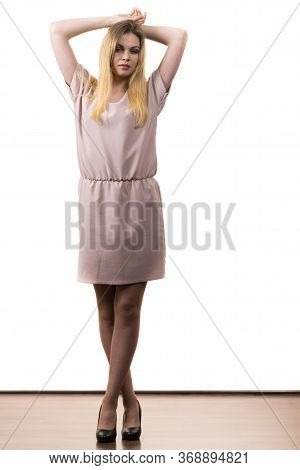 Fashionable Pretty Woman Wearing Elegant Casual Pink Tunic Dress Presenting Stylish Elegant Outfit.