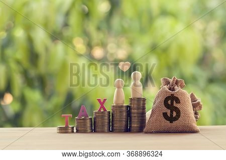 Family Members, Us Money Bags On Rows Of Rising Coins And Graph Growth Business Investment On Table.