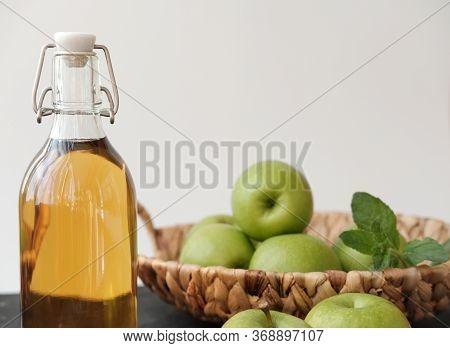Apple Vinegar. Bottle Of Homemade Apple Organic Vinegar Or Cider On Grey Background. Healthy Organic
