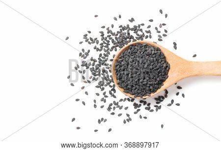 Black Sesame Seeds On Wood Spoon Isolated On White Background. The Benefits Of Black Sesame Help To